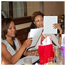 Brunch attendees Karla and Cherise try a couple diffeent methods to learn their color temperature.